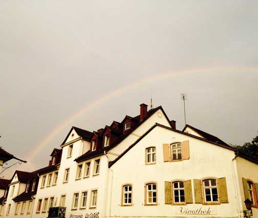 Rainbow over village